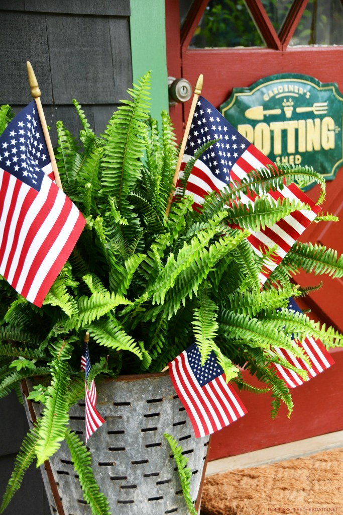 Fern in olive bucket with American Flags | ©homeiswheretheboatis.net #patriotic #flag #redwhiteandblue