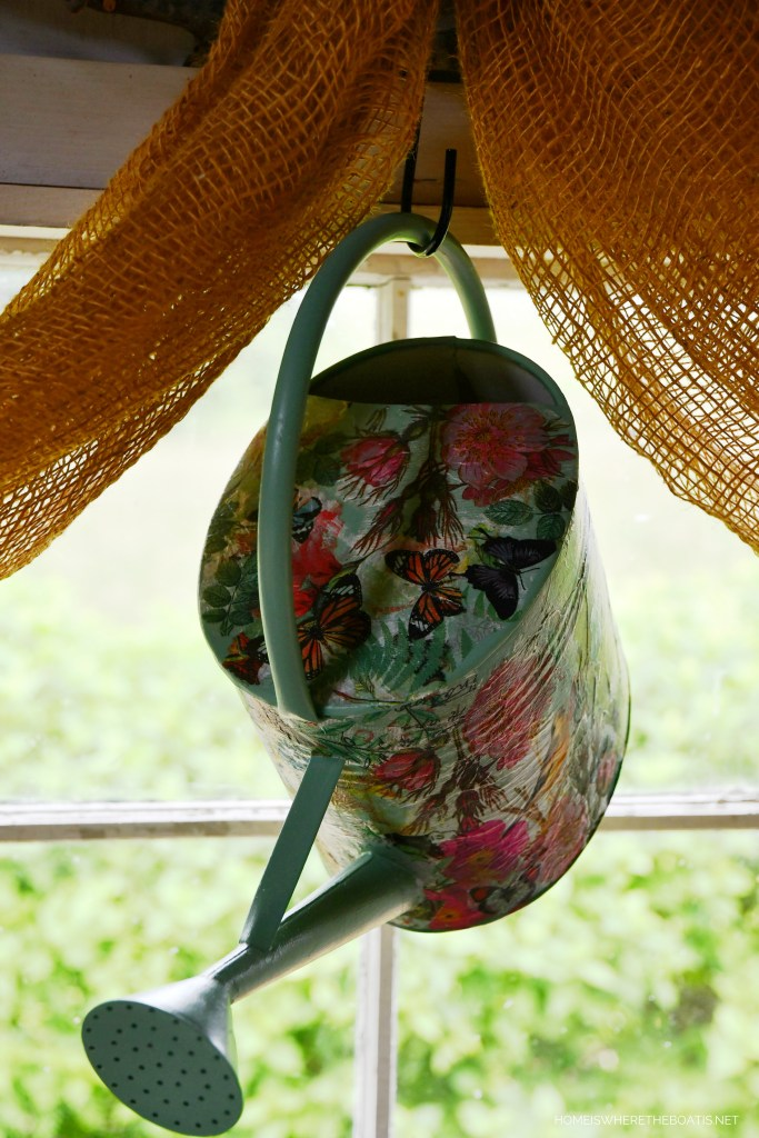 Decoupage Watering Can hanging in the Potting Shed | ©homeiswheretheboatis.net