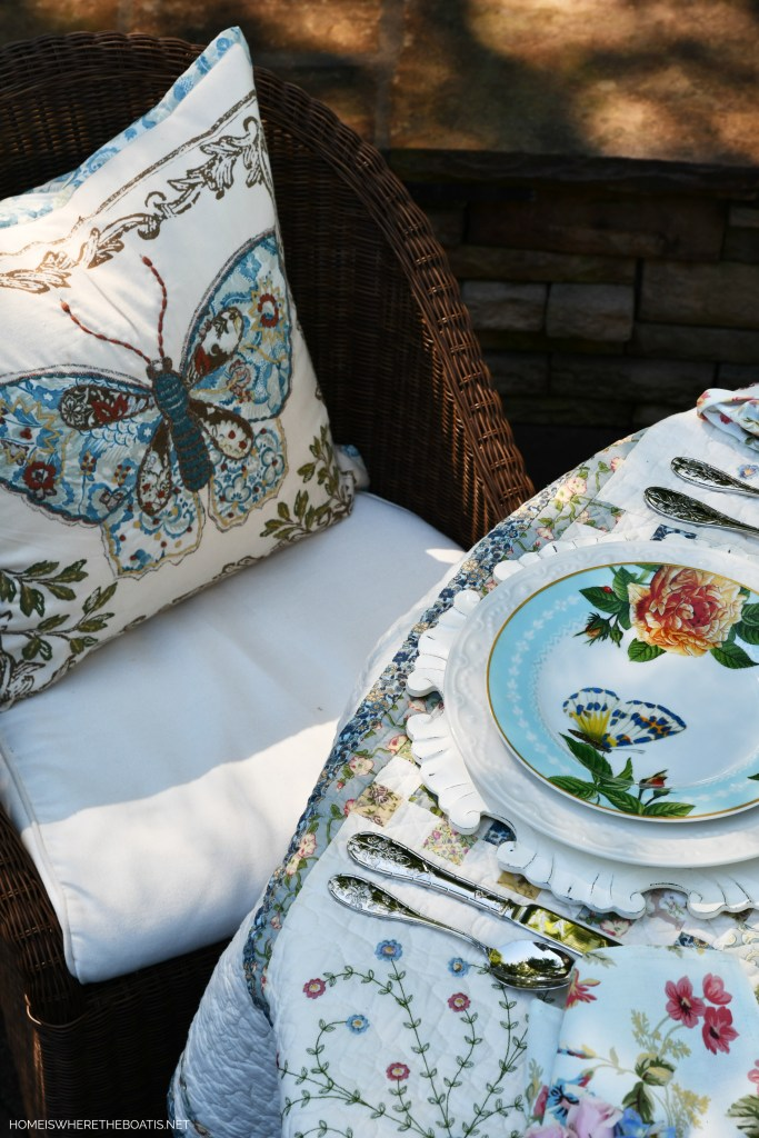 Butterfly pillow and salad plate | ©homeiswheretheboatis.net #spring #alfresco #tablescapes