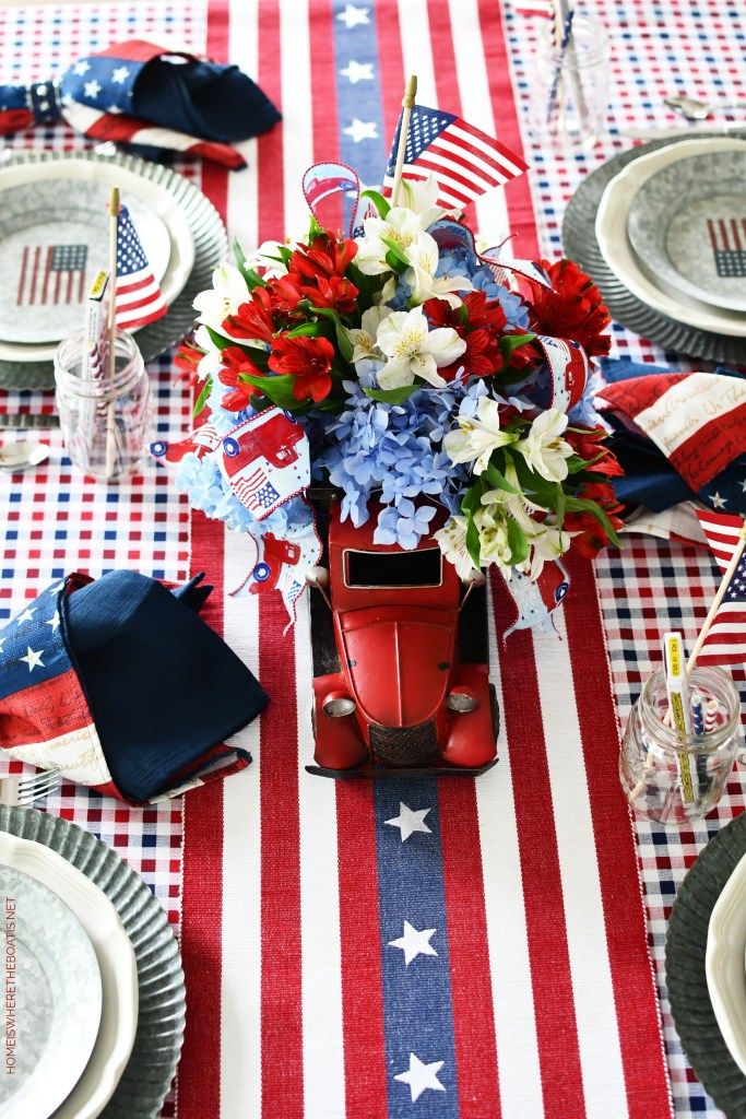 Patriotic Table with DIY Red Truck Flower Arrangement for Independence Day | ©homeiswheretheboatis.net #patriotic #tablescapes #redtruck #redwhiteandblue #july4th