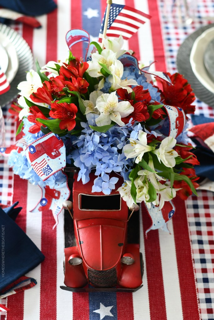Red truck flower centerpiece and tablescape for the 4th of July | ©homeiswheretheboatis.net #patriotic #tablescape #centerpiece #flag #4thofjuly