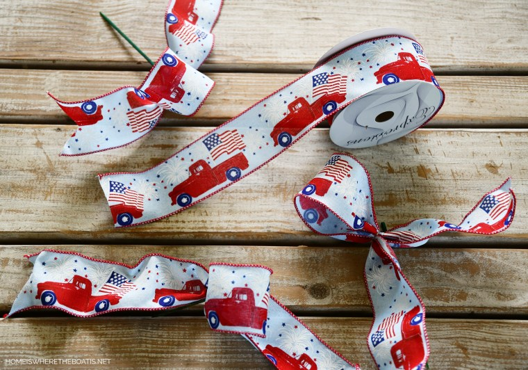 Ribbon for DIY patriotic flower centerpiece with a red truck | ©homeiswheretheboatis.net #patriotic #tablescape #centerpiece #flag #4thofjuly