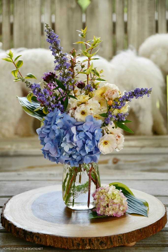 Lola and Sophie photobombing Ball jar bouquet of garden flowers | ©homeiswheretheboatis.net #jars #flowers