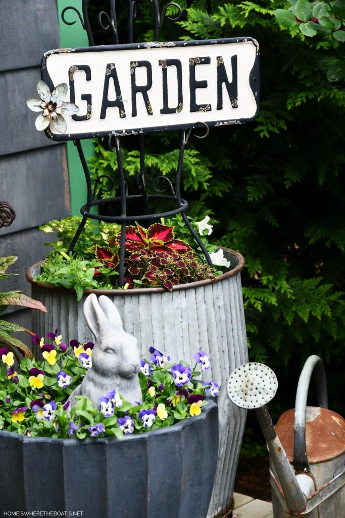 Garden planters with bunny | ©homeiswheretheboatis.net #flowers #garden