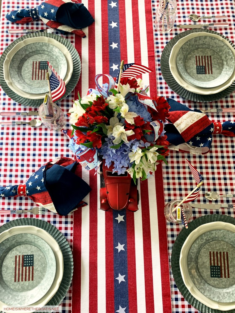 Patriotic tablescape for the 4th of July | ©homeiswheretheboatis.net #patriotic #tablescape #centerpiece #flag #4thofjuly