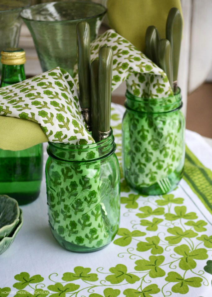 Green Ball Jars with flatware and napkins for St. Patrick's Day | ©homeiswheretheboatis.net #masonjars #stpatricksday