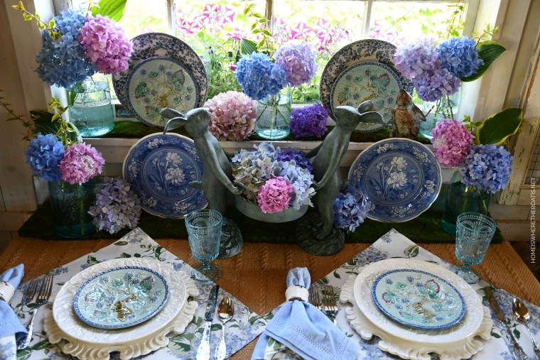 Gardener Bunnies with basket of hydrangeas and table in Potting Shed | ©homeiswheretheboatis.net #hydrangeas #tablescapes
