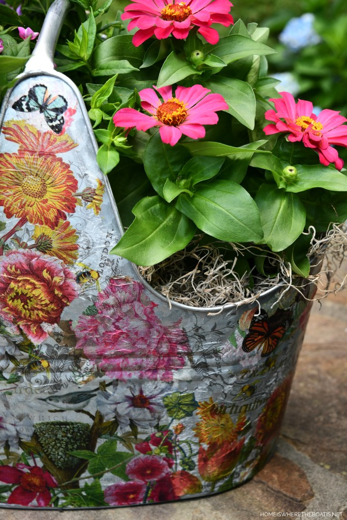 Decoupaged galvanized tub as a planter | ©homeiswheretheboatis.net #DIY #craft