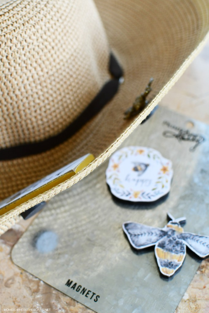 Add bees to hat with bee magnets for door decor for Potting Shed | ©homeiswheretheboatis.net #bees #flowers #garden #shed