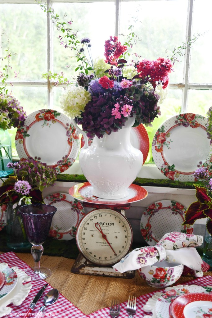 Garden Bouquet in ironstone pitcher with vintage scale and floral dinnerware | ©homeiswheretheboatis.net #tablescapes #redandwhite #flowers