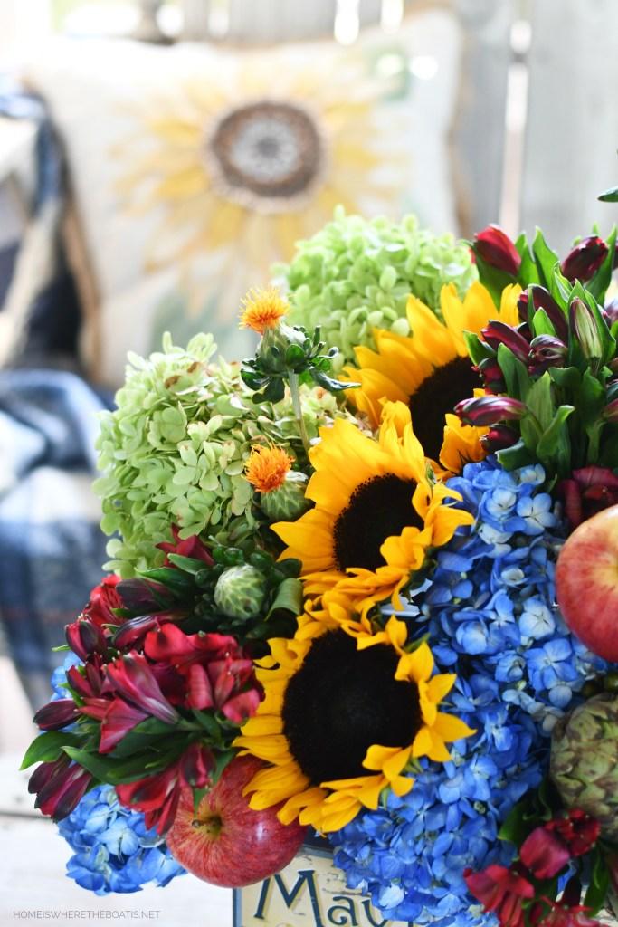 DIY transitional flower arrangement with hydrangeas, sunflowers, apples and artichokes   ©homeiswheretheboatis.net #hydrangeas #sunflowers