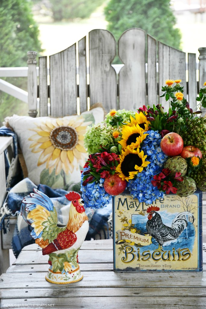 DIY transitional flower arrangement with biscuit tin | ©homeiswheretheboatis.net #hydrangeas #sunflowers #rooster
