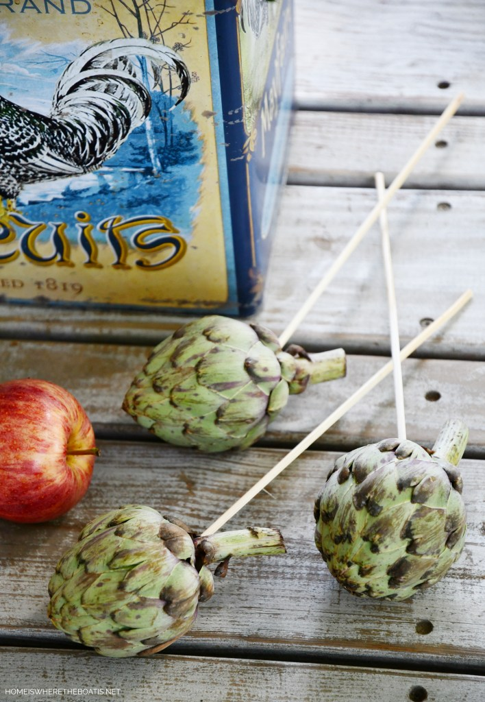 DIY transitional flower arrangement incorporating artichokes and apples   ©homeiswheretheboatis.net #hydrangeas #sunflowers