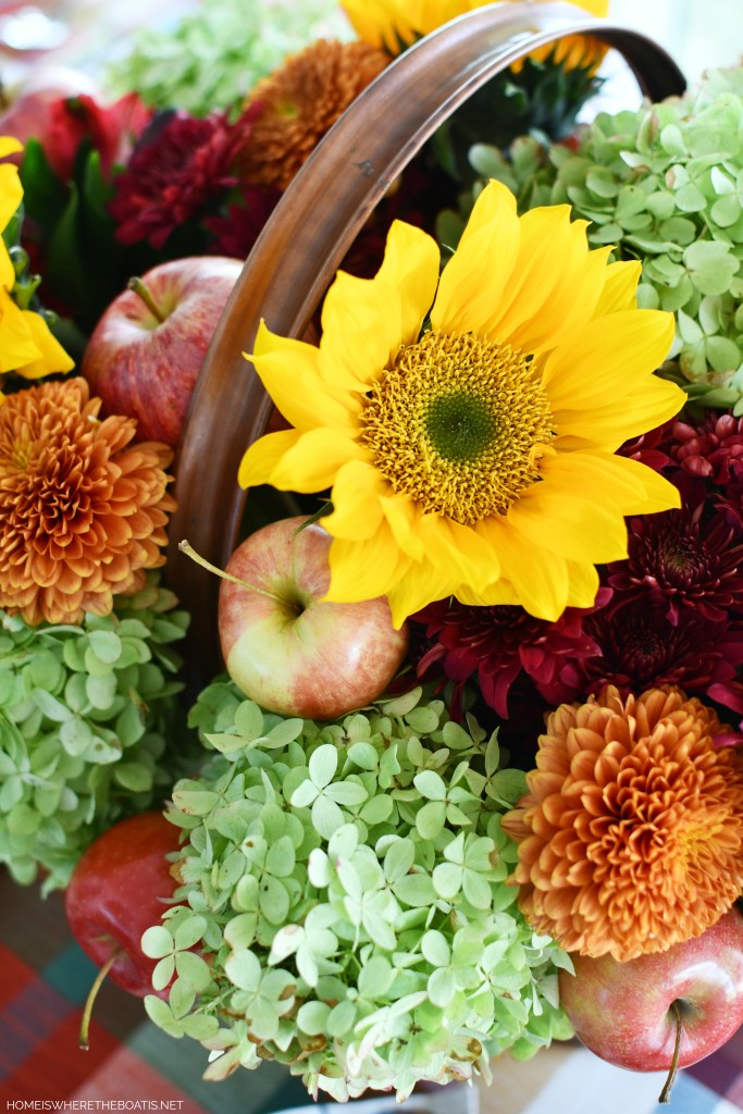'Falling for Apples' Flower Arrangement with Sunflowers and Transitional Fall Table | ©homeiswheretheboatis.net #fall #tablescapes #apples #plaid #sunflowers