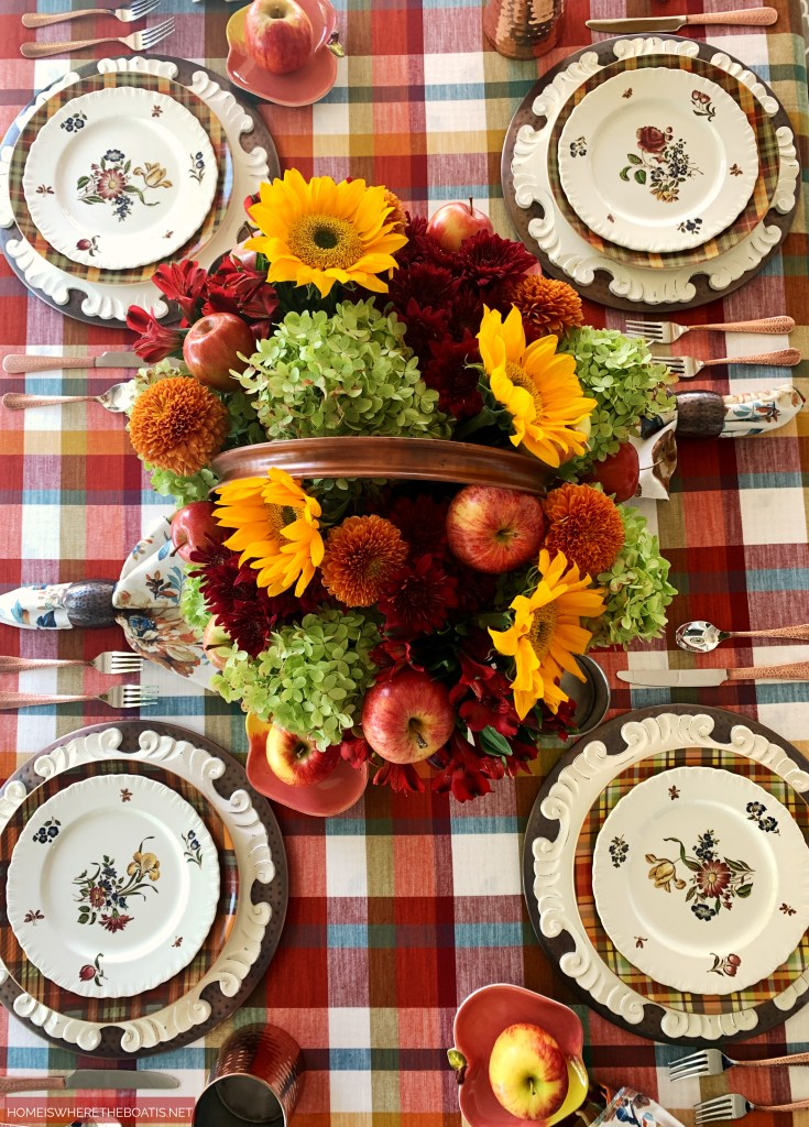 Falling for Apples Transitional Fall Table | ©homeiswheretheboatis.net #fall #tablescapes #apples #plaid #sunflowers