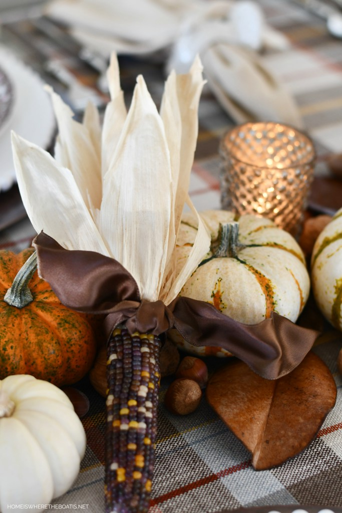 Indian corn tied with brown satin ribbon for Thanksgiving | ©homeiswheretheboatis.net #thanksgiving #tablescapes #DIY