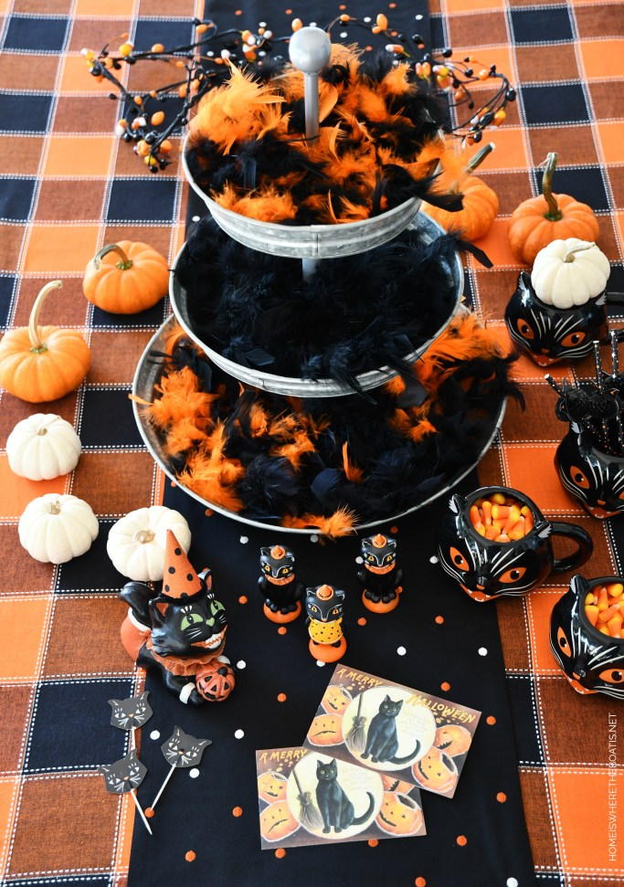 Halloween table centerpiece with galvanized tiered tray | ©homeiswheretheboatis.net #halloween #tablescapes