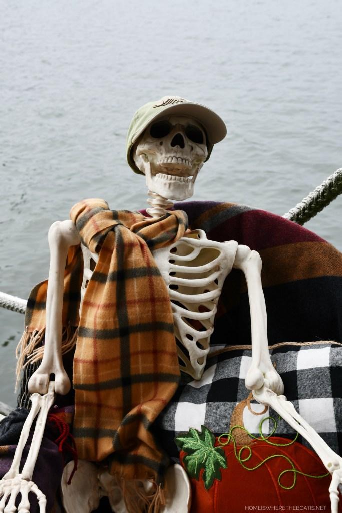 Skeleton on dock for Halloween | ©homeiswheretheboatis.net #halloween #tablescape #skeleton