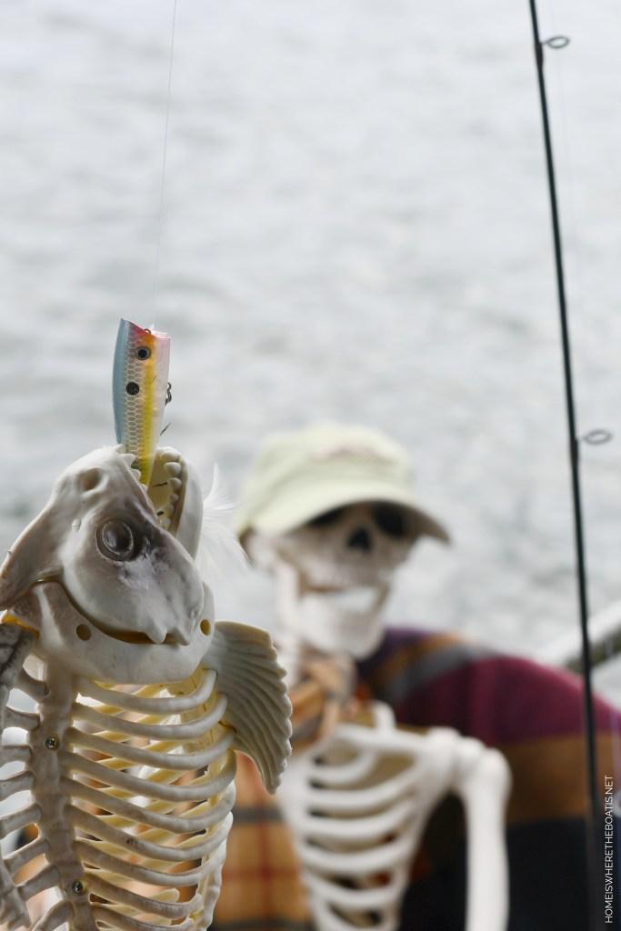 Skeleton fishing dock lake Halloween | ©homeiswheretheboatis.net #halloween #tablescape #skeleton