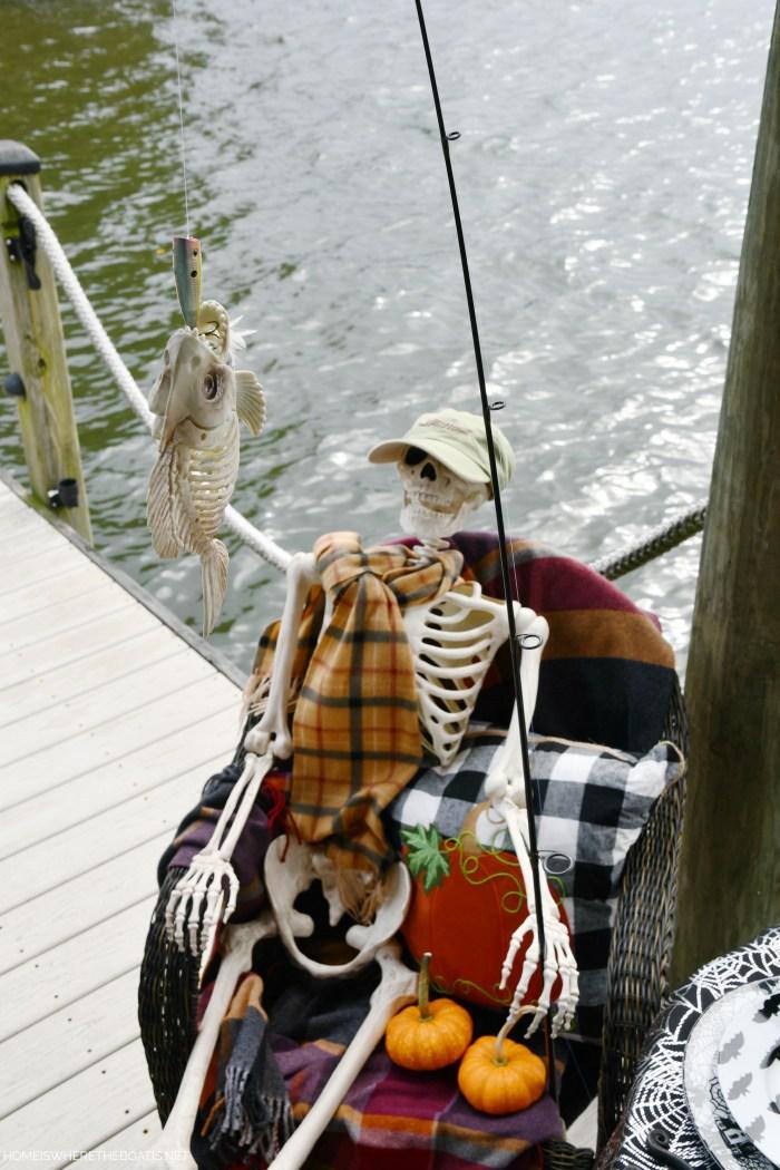 Skeleton fishing dock lake Halloween | ©homeiswheretheboatis.net #halloween #tablescape #skeleton #lake