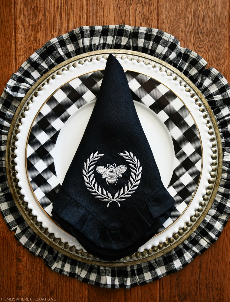Crown Linen Designs bee linen napkin and black and white check ruffled placemats | ©homeiswheretheboatis.net #christmas #tablescapes