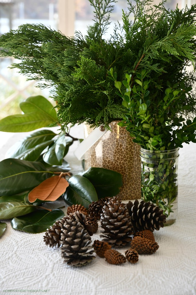 DIY evergreen runner for Christmas | ©homeiswheretheboatis.net #christmas #tablescapes