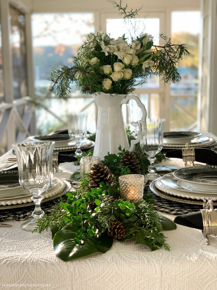 Christmas tablescape with Arte Italica pitcher centerpiece, evergreen runner and black and white checks | ©homeiswheretheboatis.net #christmas #tablescapes