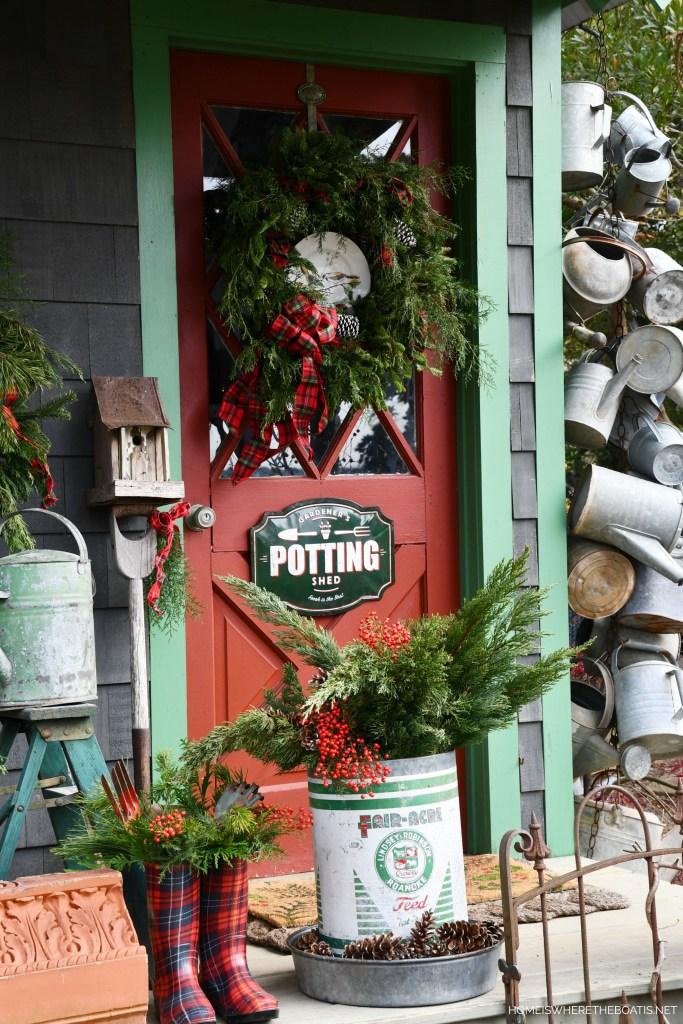 Christmas Around the Potting Shed | ©homeiswheretheboatis.net #pottingshed #christmas #wreath #greenery #garden