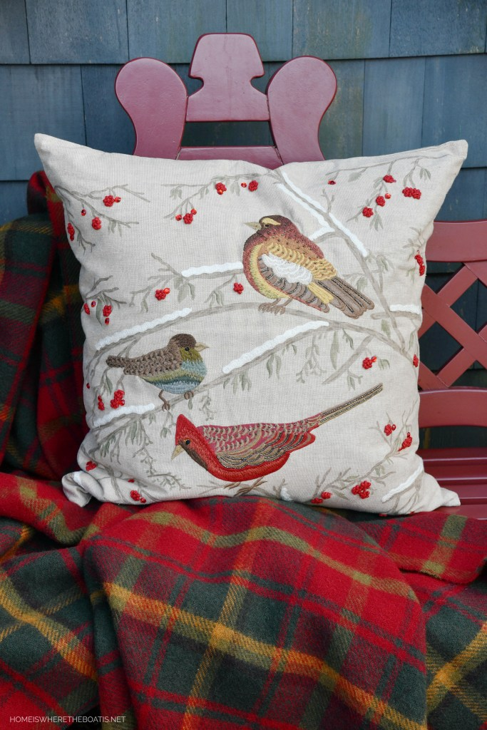 Christmas pillow with birds on bench by Potting Shed | ©homeiswheretheboatis.net #windowboxes #evergreens #christmas