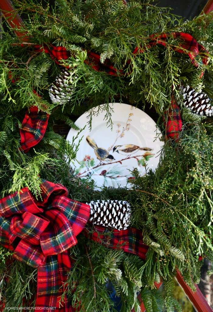 Christmas wreath with bird plate and tartan ribbon on Potting Shed door | ©homeiswheretheboatis.net #pottingshed #christmas #wreath #greenery #garden