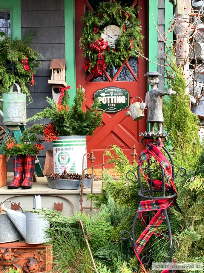Mrs. Powers Tuteur with tartan ribbon and greenery for Christmas around the Potting Shed | ©homeiswheretheboatis.net #shed #christmas #greenery