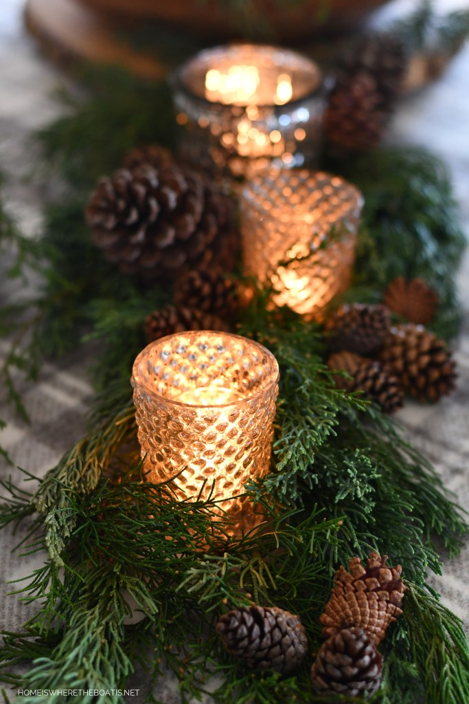 Mercury glass votives, greenery and pine cones Winter Owl Table | ©homeiswheretheboatis.net #tablescapes #winter #owl #DIY