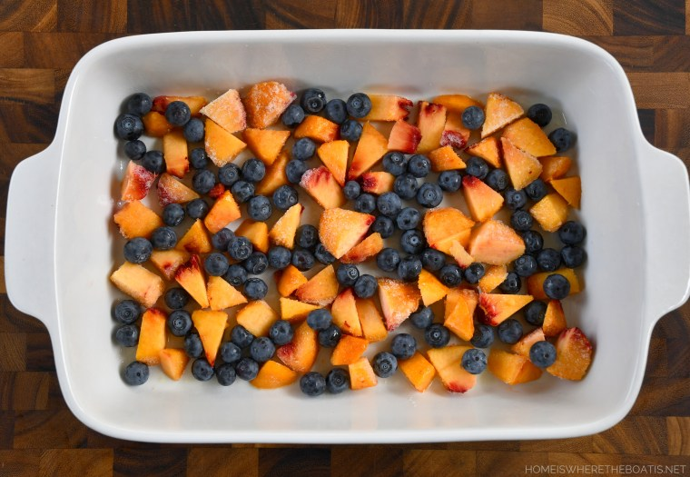 Variation of Cinnamon Roll French Toast Bake with peaches and blueberries | ©homeiswheretheboatis.net #easy #brunch #casserole #frenchtoast #cinnamonrolls