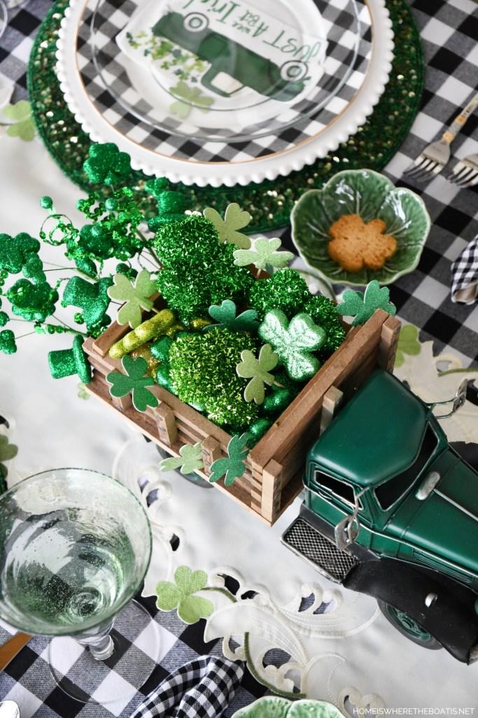 St. Patrick's Day table with truck delivering shamrocks | ©homeiswheretheboatis.net #stpatricksday #tablescapes