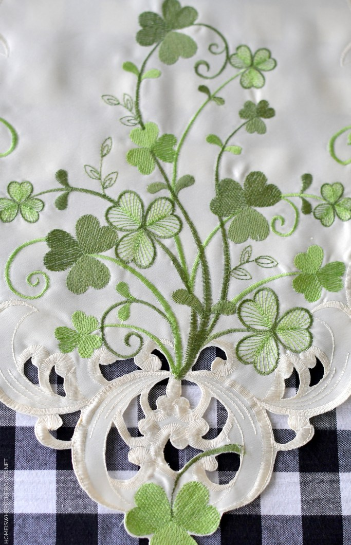 St. Patrick's Day table with embroidered shamrock runner | ©homeiswheretheboatis.net #stpatricksday #tablescapes