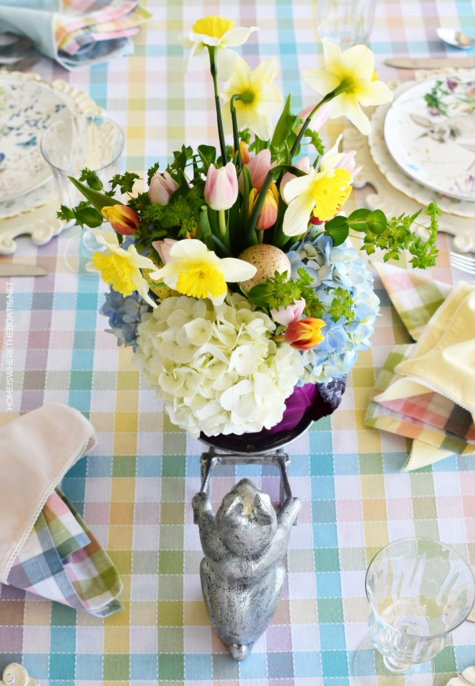 Bunny wheelbarrow and DIY Blooming Cabbage Flower Arrangement | ©homeiswheretheboatis.net #DIY #easter #spring #flowers #tablescape