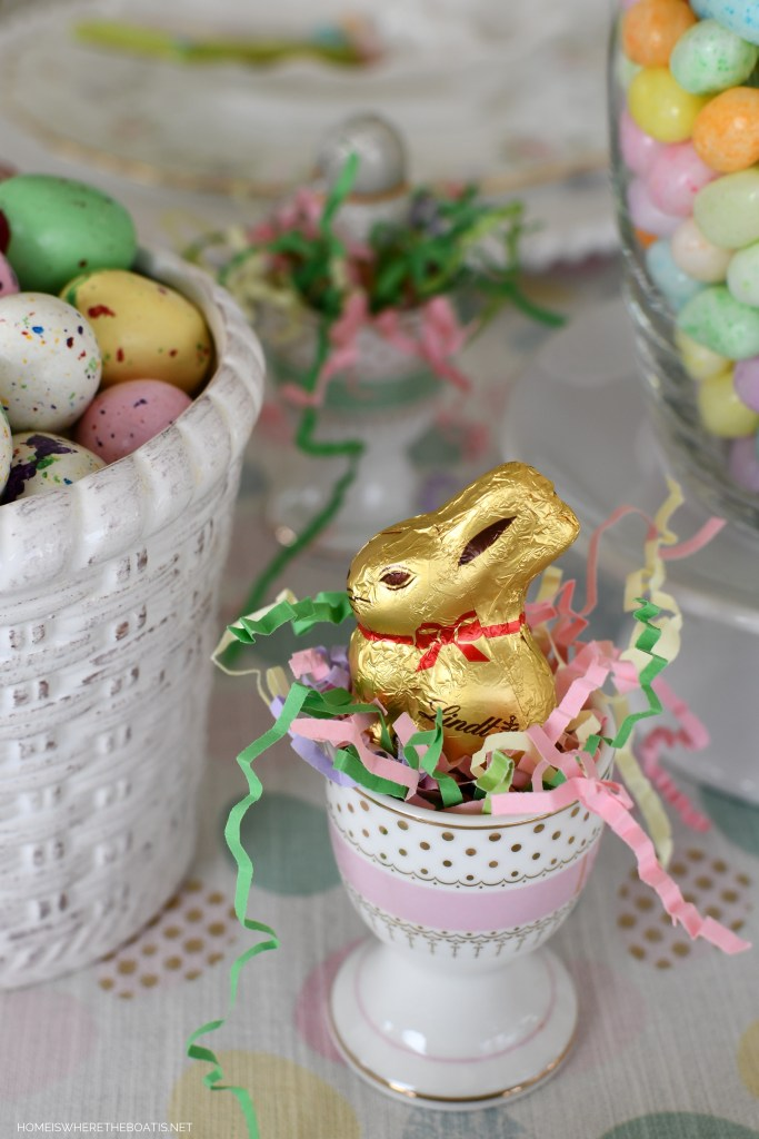 Lindt mini chocolate bunny in egg cup for Easter | ©homeiswheretheboatis.net #easter #tablescapes #bunny