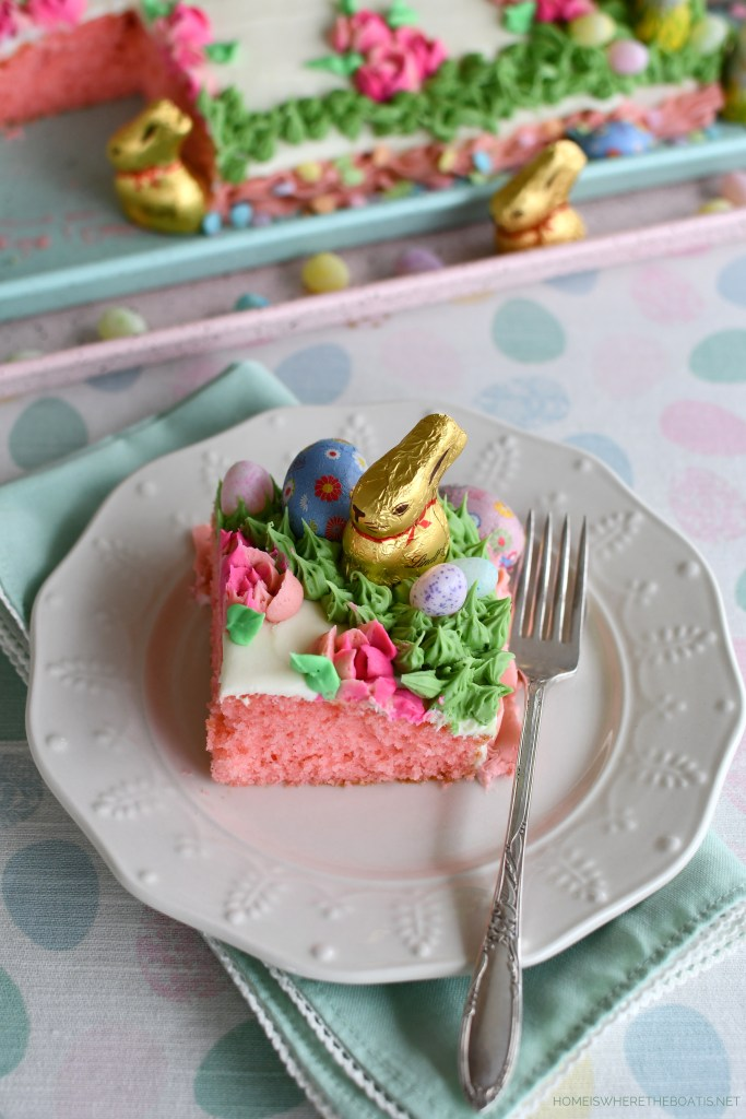 Decorate a cake with chocolate bunnies, chicks and candy for Easter | ©homeiswheretheboatis.net #easter #dessert #cake #recipe