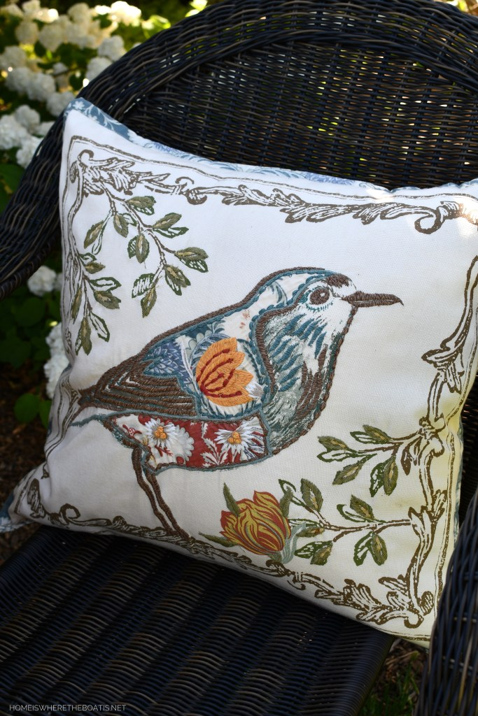 Embroidered pillow with bird | ©homeiswheretheboatis.net #spring #flowers #garden #tablescape #alfresco