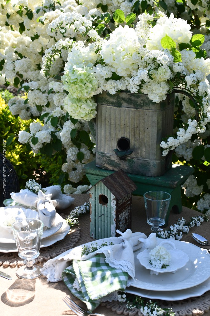 Alfresco spring table with birds and Snowball Viburnum | ©homeiswheretheboatis.net #spring #flowers #garden #tablescape #alfresco