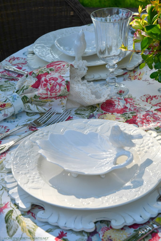 Spring alfresco table with bird dishes | ©homeiswheretheboatis.net #spring #flowers #diy #tablescape #alfresco