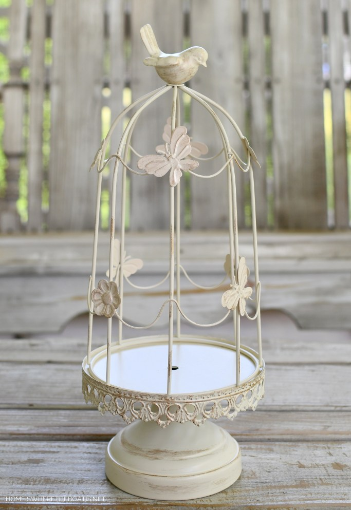 How to Make a Flower Arrangement Using A Decorative Bird Cage | ©homeiswheretheboatis.net #spring #flowers #diy