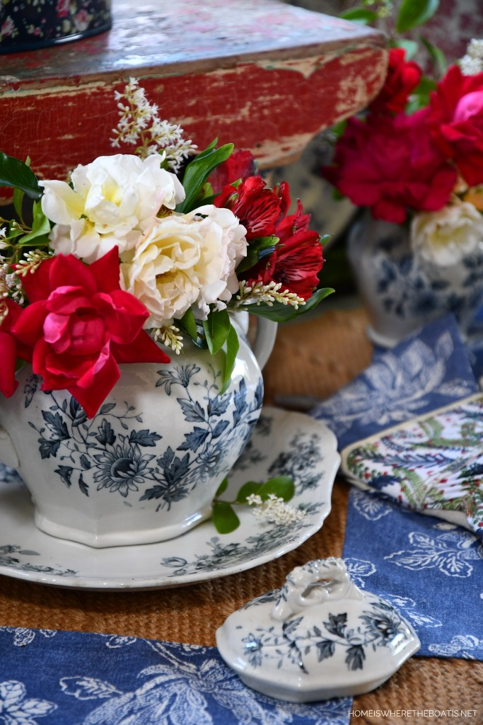 Red, White and Blue tablescape with vintage transferware and flowers | ©homeiswheretheboatis.net #redwhiteandblue #transferware #flowers #tablescape #memorialday