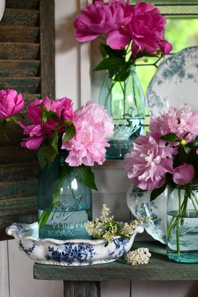 Peonies and Ball Jar Bouquets in the Potting Shed | ©homeiswheretheboatis.net #peonies #flowers #balljars #transferware #pottingshed #masonjars