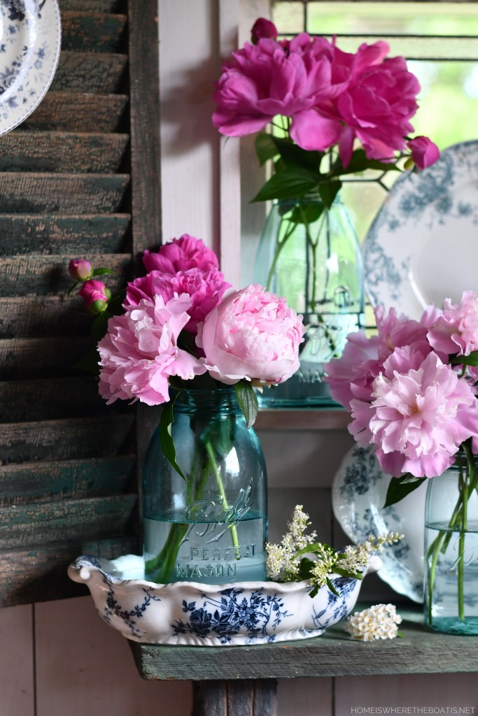 Peonies and Ball Jar Bouquets with blue and white transferware in the Potting Shed | ©homeiswheretheboatis.net #peonies #flowers #balljars #transferware #pottingshed #masonjars