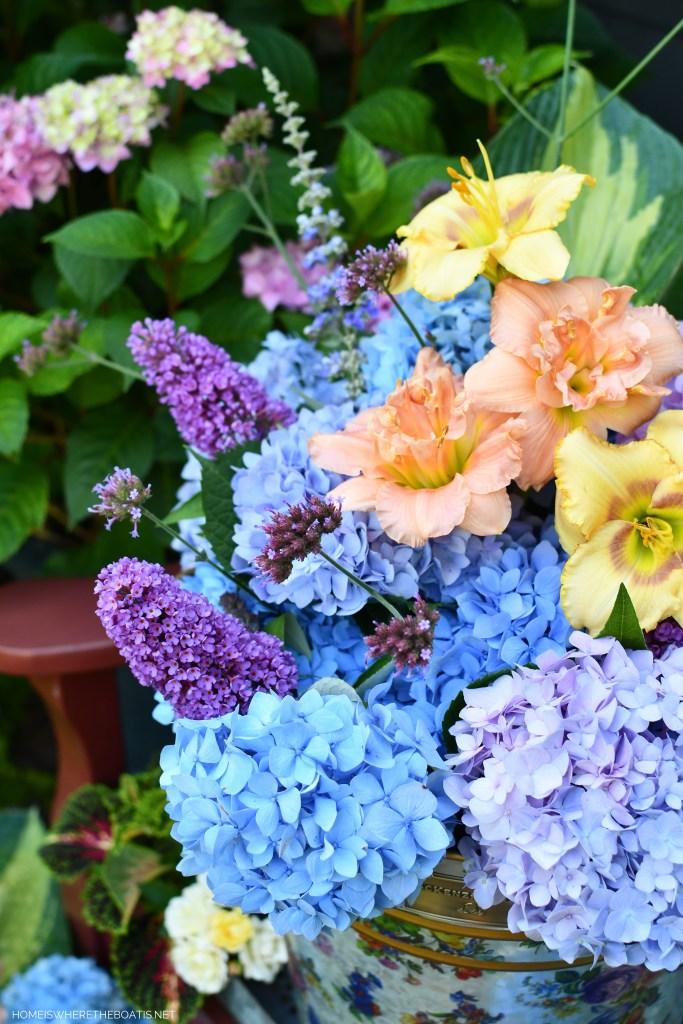 MacKenzie-Childs Flower Market Galvanized Metal Bucket filled with garden blooms