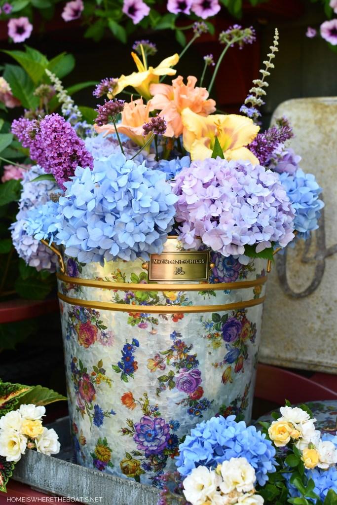MacKenzie-Childs Flower Market Galvanized Metal Bucket filled with garden blooms | ©homeiswheretheboatis.net #summer #garden #flowers #daylilies #hydrangeas #bees #butterflies