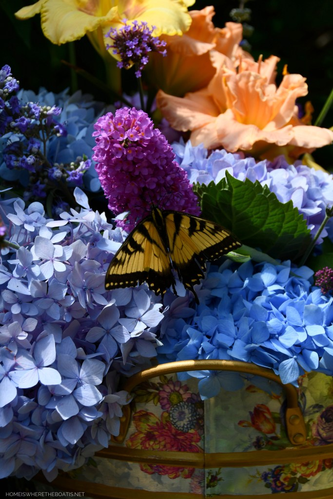 Eastern Tiger Swallowtail butterfly on butterfly bush bloom | ©homeiswheretheboatis.net #summer #garden #flowers #daylilies #hydrangeas #bees #butterflies