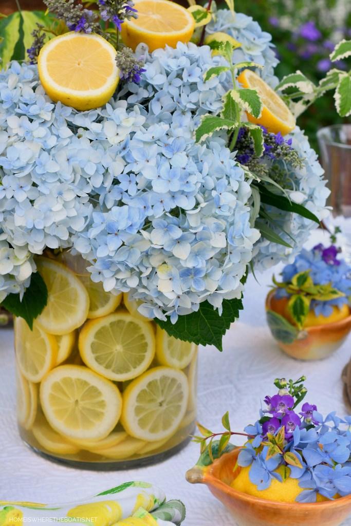 How to Create a Lemon Vase Flower Arrangement and Alfresco Summer Table | ©homeiswheretheboatis.net #DIY #tablescapes #lemons #hydrangeas #flowers #summer #alfresco