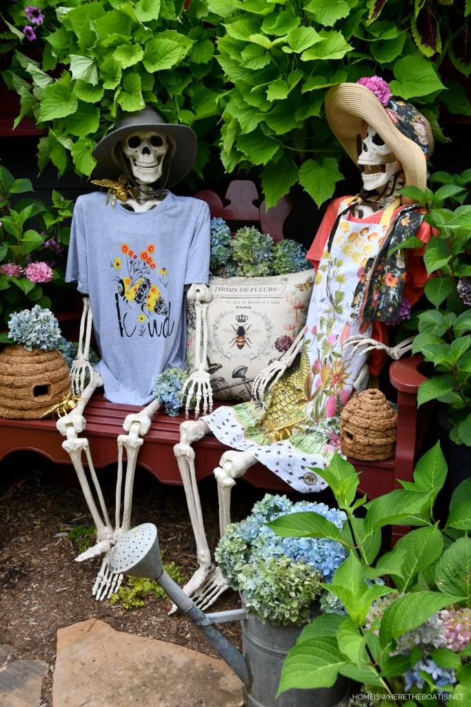 Rod and Rowena take a break from gardening | ©homeiswheretheboatis.net #skeleton #halloween #garden #flowers #bees